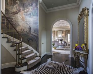 A penthouse entry foyer looking into the living room